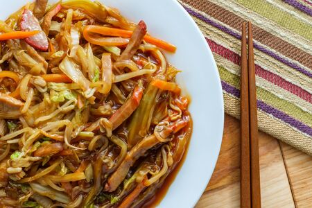 Chinese shredded pork peking style with vegetables and chopsticks