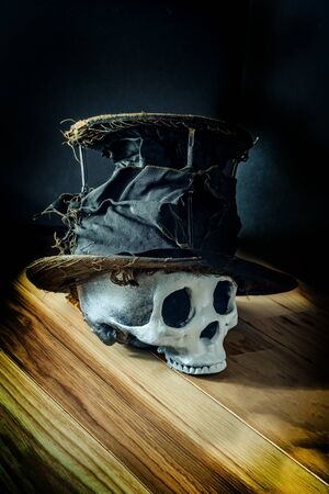 Scary jawless Halloween skull wearing old distressed top hat