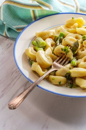Italian butter and parmesan cheese tortellini alfredo with asparagus