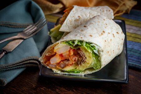 Egg and sausage with cheese American breakfast sandwich wrap Stock Photo
