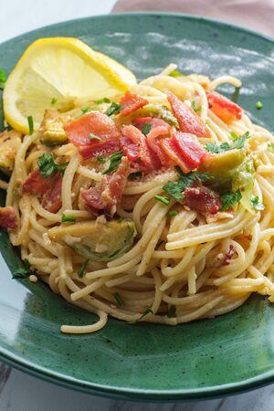 Creamy Italian cuisine spaghetti alla carbonara with bacon and brussel sprouts