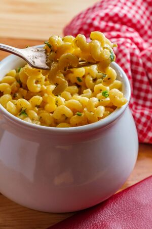 Delicious macaroni and cheddar cheese cellentani pasta in a bowl Stock fotó
