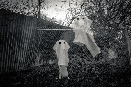 Spooky Halloween ghost spirits floating in the air