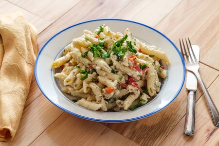 Greek penne Aegean pasta salad with crumbled feta cheese