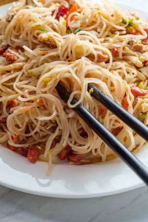 Chinese pork mei fun also known as Singapore-style noodles