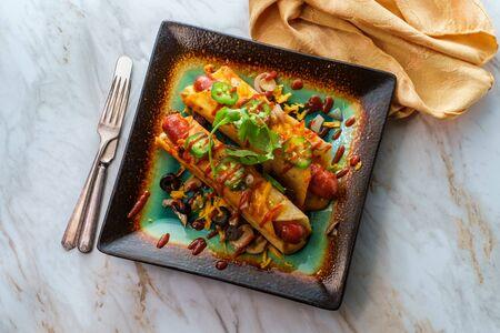 Gluten-free diet no-bun Mexican cheese corn-tortilla wrap hot dogs with hot sauce Standard-Bild