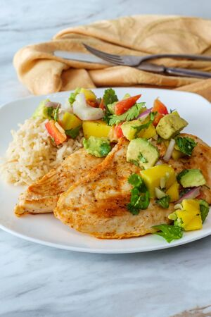 Gluten-free Mexican grilled chicken with mango and avocado salsa