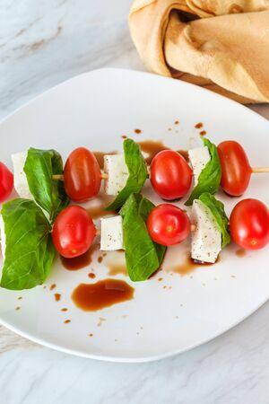Fresh caprese salad with extra virgin olive oil balsamic vinegar and salt pepper Stock Photo