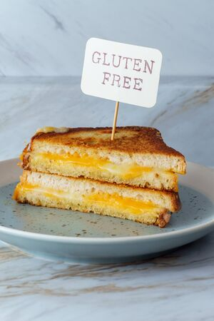 Gluten-free American grilled cheese sandwich on marble kitchen table Stock fotó