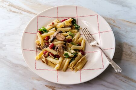 Kidney bean mushroom kale penne pasta with white wine butter sauce
