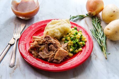 Southern American cuisine slow cooked barbecue pulled pork with creamy mashed potatoes and vegetables