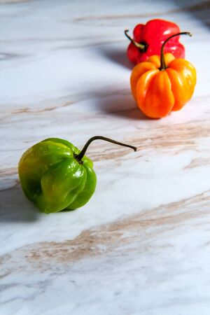 Spicy jamaican scotch bonnet pepper on marble kitchen table