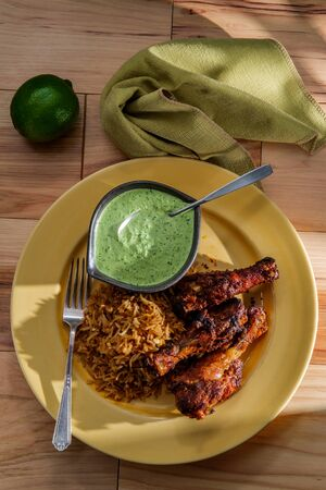 Peruvian chicken legs with aji verde green cilantro sauce and fried rice
