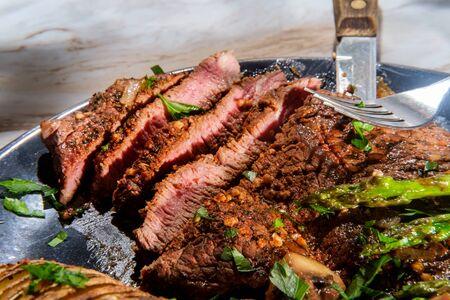 Sirloin tip steak with potato a la hasselbacken mushrooms and asparagus