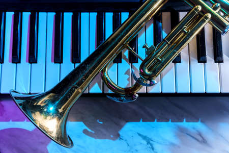 Old and worn Jazz trumpet and piano keyboard musical show and performance