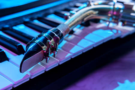Old and worn Jazz saxophone and piano keyboard musical show and performance