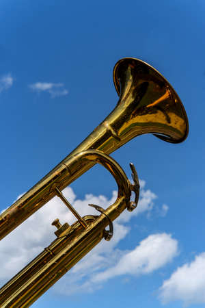 Trumpet against blue sky during marching band celebration