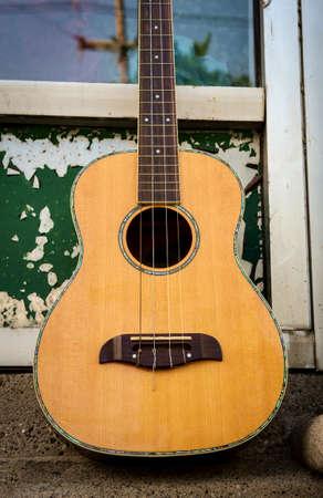 Acoustic baritone ukulele guitar Stock fotó