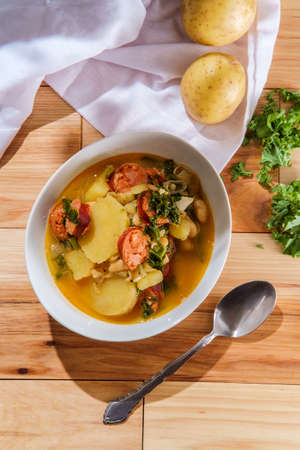 Traditional Portuguese caldo verde linguica sausage soup with kale and yukon gold potatoes