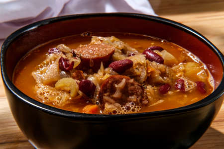 Traditional Polish sauerkraut kielbasa sausage and bean soup Stock Photo