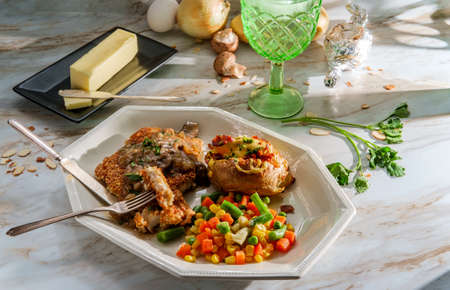 German almond chicken jagerschnitzel with loaded baked potato and vegetables