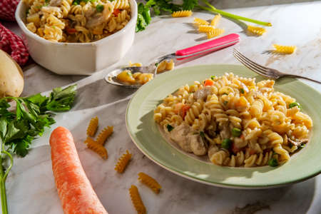 Chicken pot pie noodle casserole with sun shining in through window Stock Photo