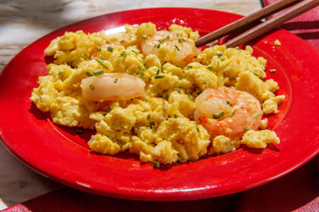 Chinese cuisine stir-fried shrimp scrambled eggs garnished with chives