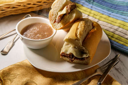 Cheesy French dip beef sandwich with melted provolone cheese Banque d'images