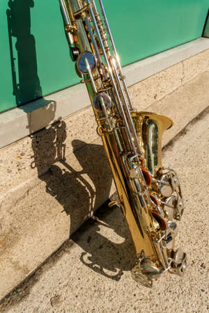 Outdoor Jazz entertainment musical instrument saxophone with grungy street background