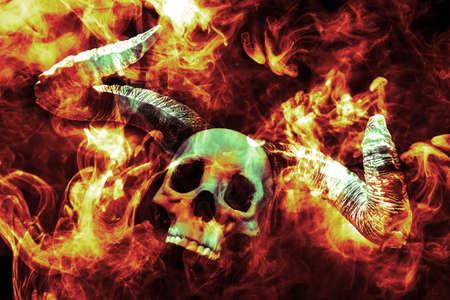 Scary demon Halloween skeleton skull burning in fire Stock Photo