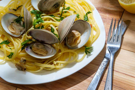 Linguine with littleneck white wine clam sauce and parsley garnish