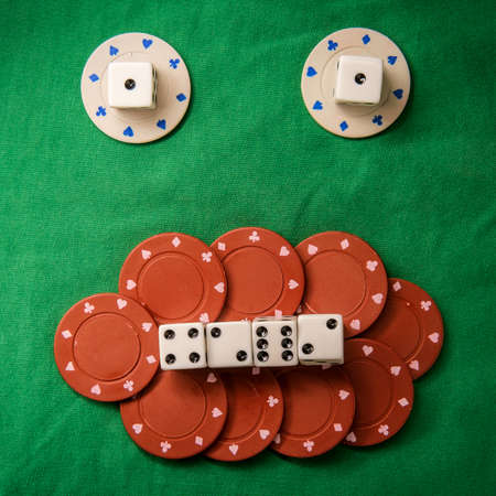 Silly bad poker face metaphor made from various gambling items including dice and poker chips
