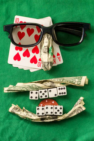 Silly bad poker face metaphor made from various gambling items including money dice cards and poker chips Stock fotó