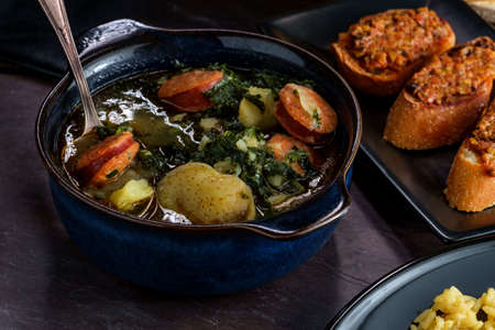 Traditional Portuguese caldo verde chourico soup with orzo rice pilaf and petiscos