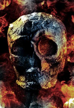 Scary demon Halloween skeleton skull burning in fire