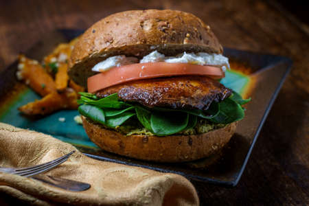 Portobello mushroom sandwich with goat cheese pesto and side of Greek sweet potato fries