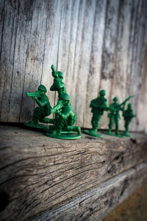 Dramatic green toy army soldiers lined up for battle