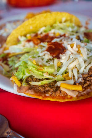 Authentic Mexican taco enchilada and tostada with refried beans and rice Stock Photo