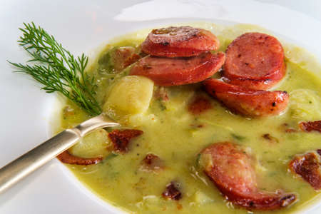 Creamy potato bacon and sausage soup also called kartoffelsuppe