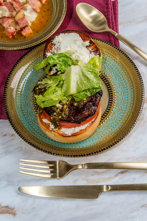 Portobello mushroom burger with pesto and goat cheese and side slow-cooker ham and cannellini bean soup