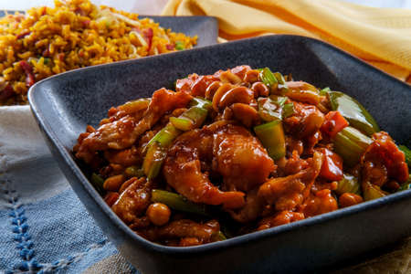 Takeout Chinese kung pao chicken and shrimp with peanuts and side of pork fried rice