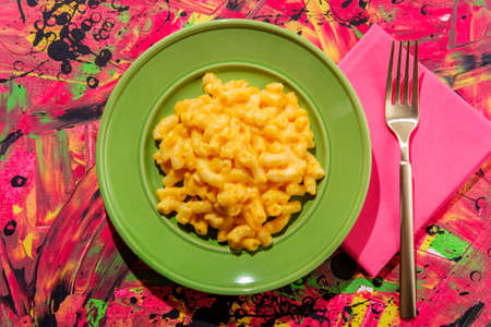 Stylized pop fashion macaroni and cheese on abstract pink background