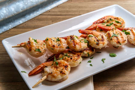 Portuguese gambas al ajillo garlic shrimp on skewers Reklamní fotografie