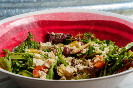 Blue cheese Mediterranean salad with multicolored tomatoes kalamata olives and artichoke hearts