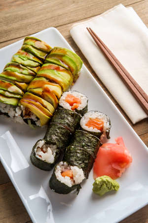 Eel avacado dragon roll and salmon roll with wasabi and pickled ginger