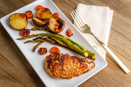 Onion crusted baked chicken breast with grilled asparagus carrots and new potatoes