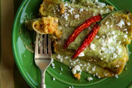 Mexican enchiladas with creamy poblano pepper sauce and queso fresco cheese