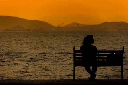 sihlouette: Women alone infront sea,sihlouette style.
