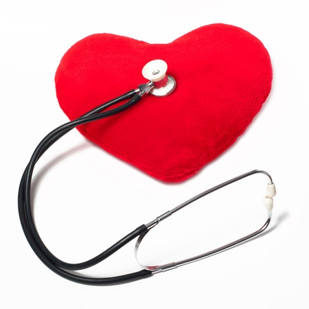 Red plush heart and stethoscope on a white background Stock Photo - 9739395