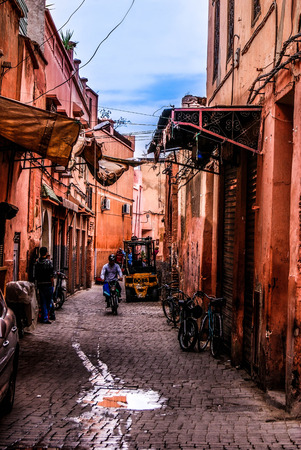 Small street in Marrakechs medina (old town). In Marrakech the houses are traditionally pink. Morocco.